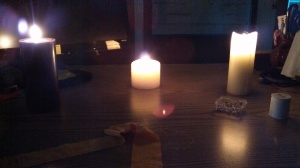 Stitching by candlelight, at the office of the National Colonial Farm.