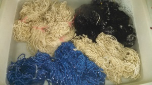 Five skeins of wool, awaiting their thwacking