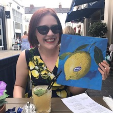 She got a free cocktail while wearing this dress, because she matched the restaurant's menu!